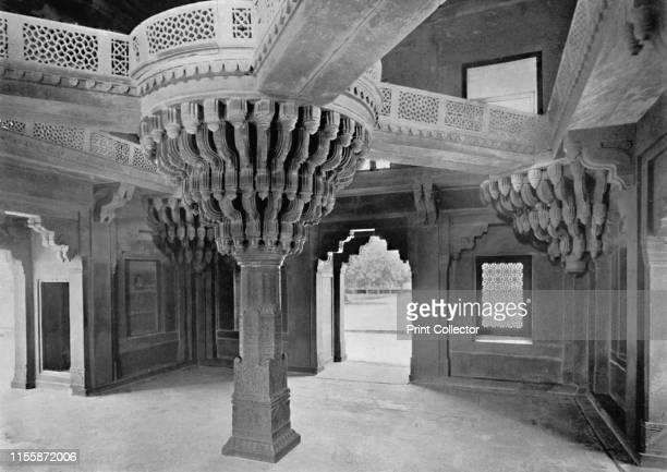"""Fatehpur Sikri. Pillar in the Dewan-i-Khas', circa 1910. From """"Cities of the Moguls"""". [Plâté Ltd., Ceylon, ]. Artist Unknown."""