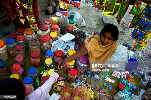 Fatema a young girl tries to help her family by running a small shop beside the road Shoronkhola Khulna Bangladesh January 16 2008 The affected...