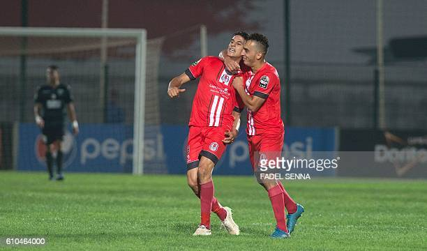 Fath Union Sport members celebrate a goal during the Mouloudia Bejaia vs Fath Union Sport Champions League CAF Semifinal match at the Prince Moulay...