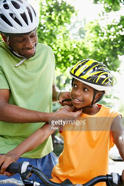 Father Adjusting Sons Helmet