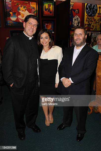 Father Albert Cutie his wife Ruhanna B Canellis and Rabbi Shmuel Shmuley Boteach attend Art Basel Aventura a Cause on sexual abuse for Ax Sex Abusers...