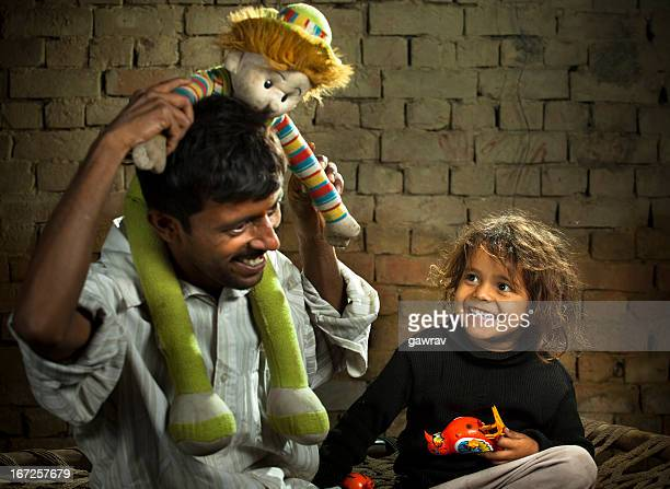 Father amusing his son with toys