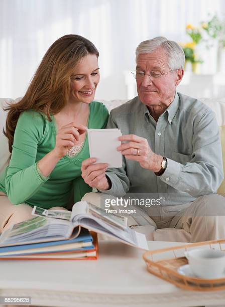 Father an daughter looking at photo albums