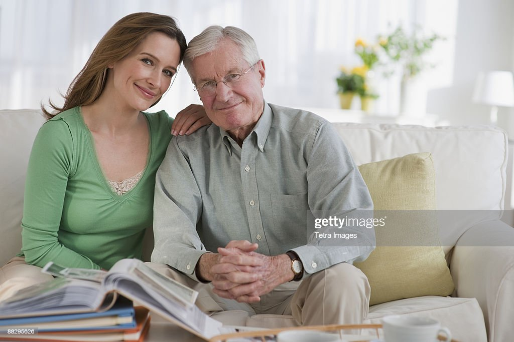 Father an daughter looking at photo albums : Stock Photo
