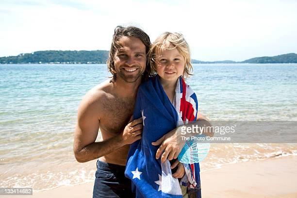Father an son Australian Christmas on the beach