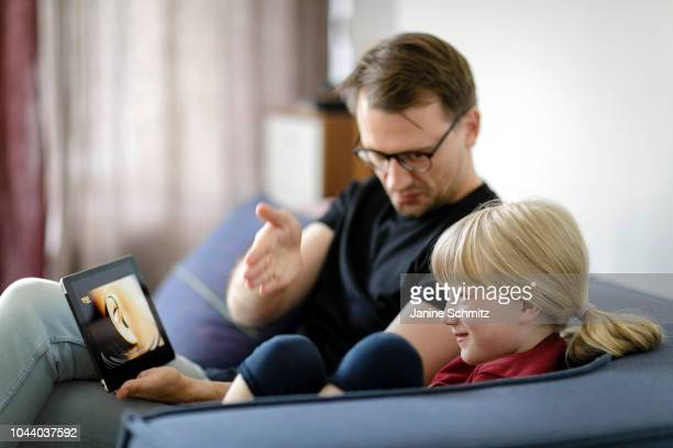 A father and a child are using a tablet together on August 14 2018 in Berlin Germany