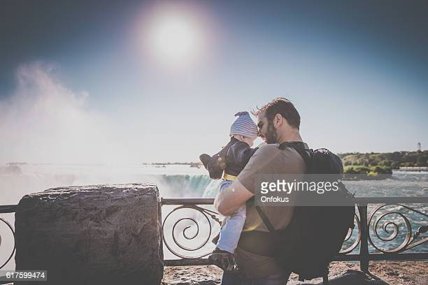 father and baby boy at niagara falls - niagara river stock pictures, royalty-free photos & images