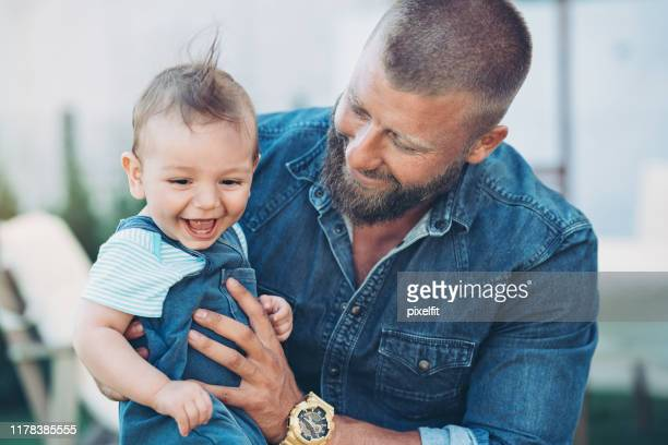 father and baby boy happy together - masculinity stock pictures, royalty-free photos & images