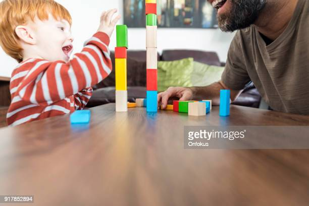 Father and Baby Boy Playing with Colorful Blocks