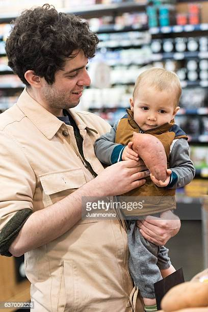 Father and Baby Boy Son shopping at a supermarket