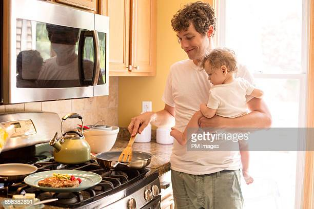 Father and baby daughter in kitchen