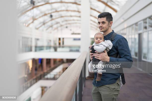 A father and baby exploring a shopping mall