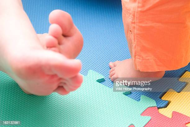 Father and baby' foot on   Foam pad