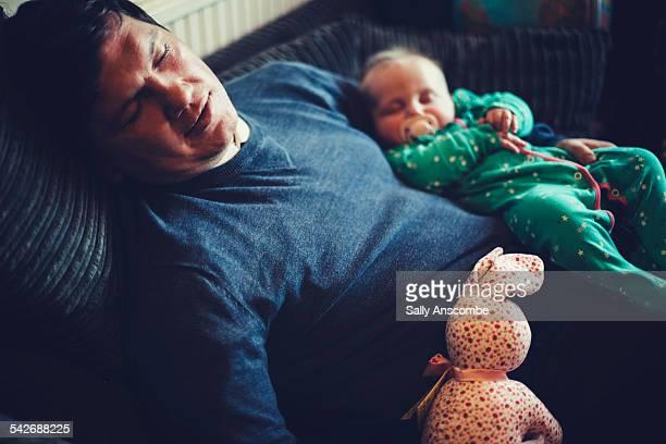 Father and baby girl sleeping