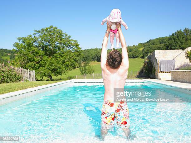 father and baby in pool