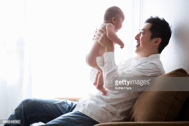 Father and baby relaxed at home