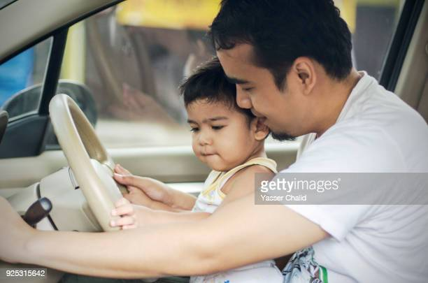 Father and Baby Son on a driver seat