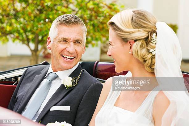 Father And Bride Looking At Each While Sitting In Car