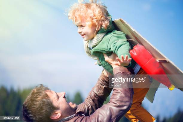 father and child imitating flying - loops7 stock photos and pictures
