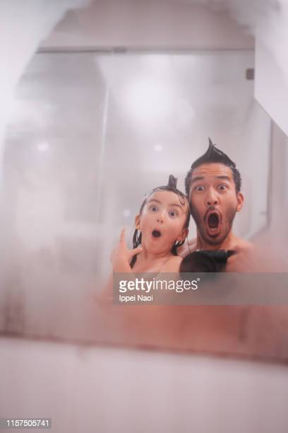 father and child making funny faces in bathroom - 変な顔 ストックフォトと画像