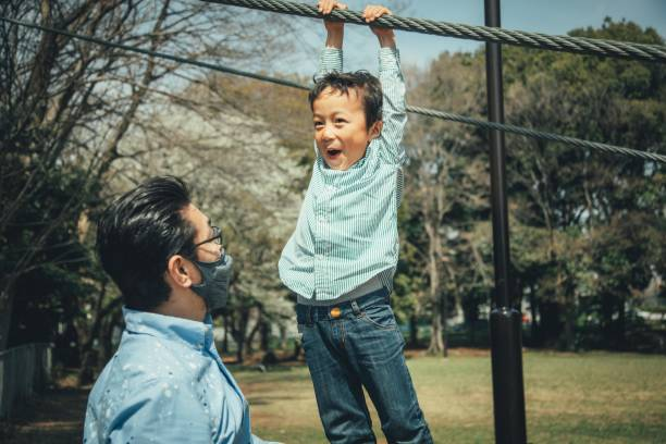 Father and child playing outdoors