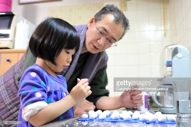 father and child quality time doing dango dumpling at home - saitama prefecture stock pictures, royalty-free photos & images