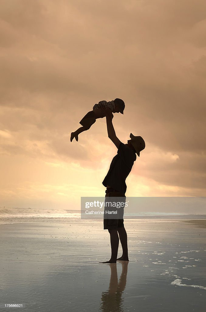 Father and Child Silhouette on the Beach : Stock Photo