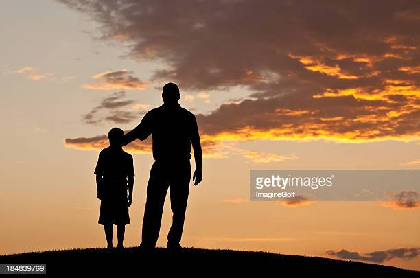 father and child silhouette - idol stock pictures, royalty-free photos & images