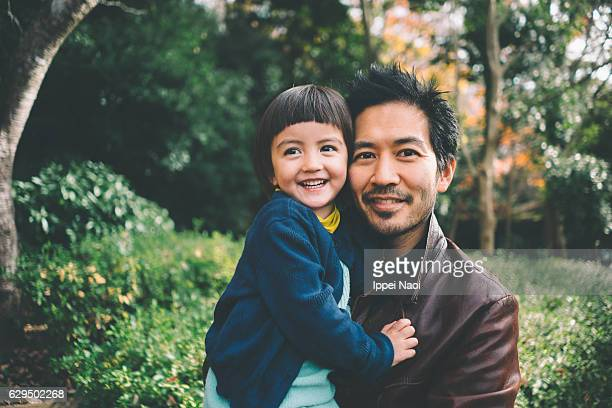 Father and child smiling at camera