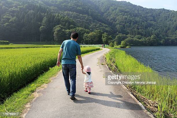Father and Child Strolling