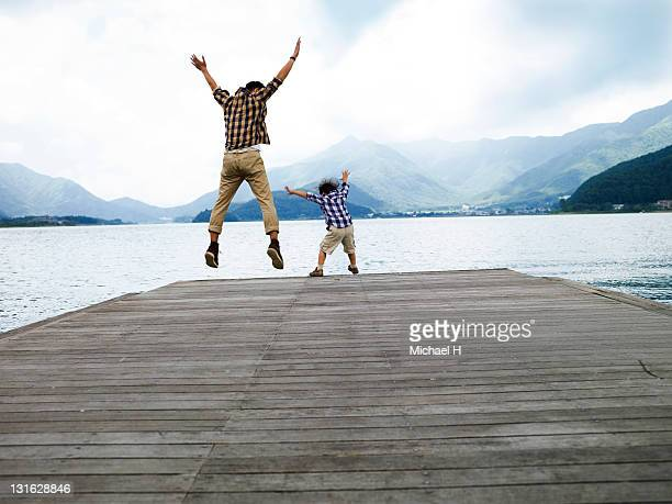 Father and child to jump on the pier