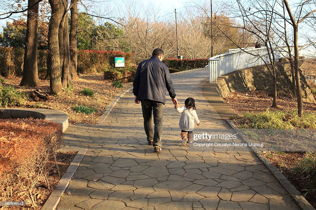Father and Child walking : Stock Photo