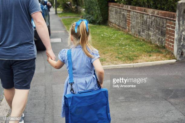 father and child walking to school - parent stock pictures, royalty-free photos & images