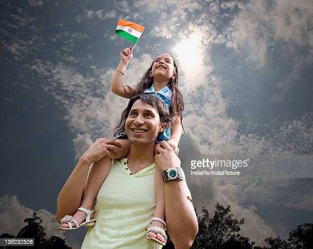 father and child with the indian flag - republic day stock pictures, royalty-free photos & images