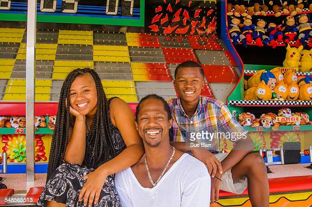 Father and children at amusement park