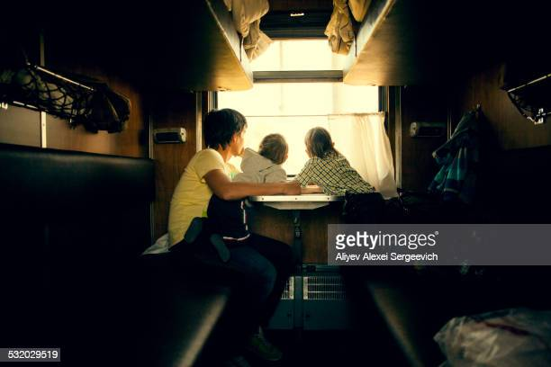 Father and children looking out trailer window