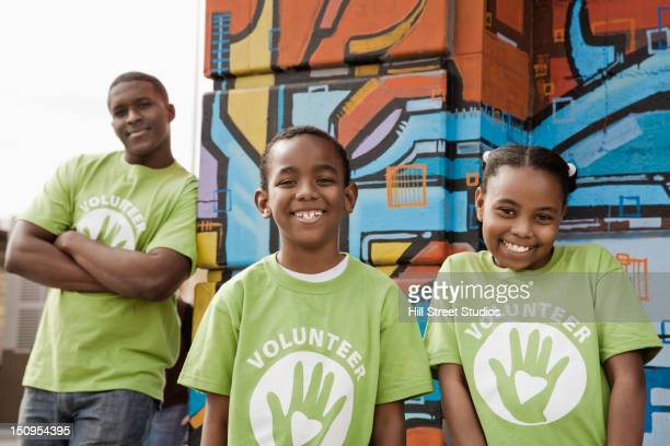 Father and children volunteering