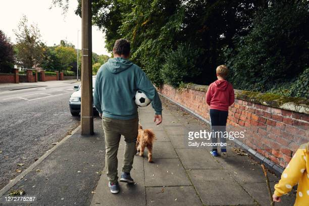 father and children walking with dog - dog walking stock pictures, royalty-free photos & images