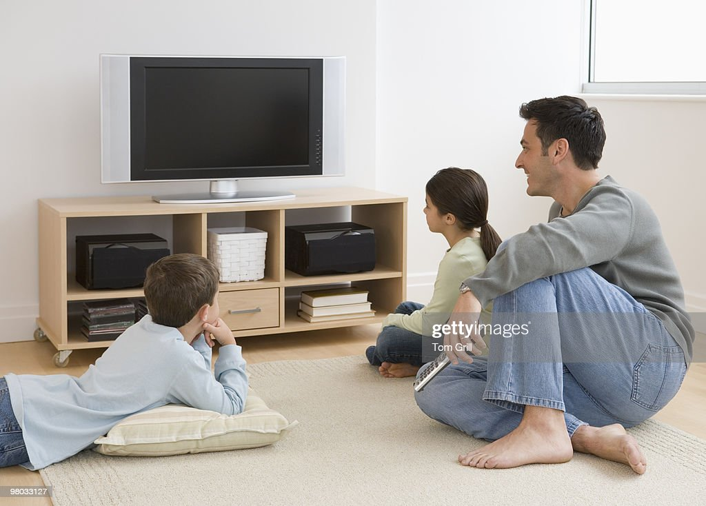 Father and children watching TV : Stock Photo