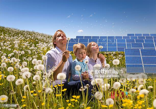 Father and children with solar panels