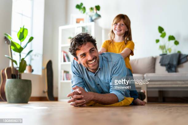 father and cute redheaded daughter having fun together at home - 8 9 jahre stock-fotos und bilder