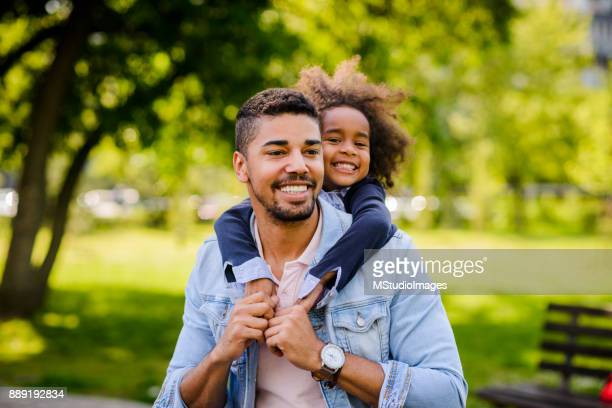 Father and daughte enjoying at the park.