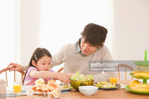 Father and Daughter at Breakfast Table