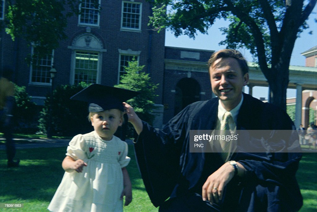 Father and daughter at graduation : Stock Photo