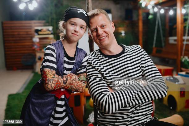 father and daughter at halloween costume party - scaredastronaut stock pictures, royalty-free photos & images