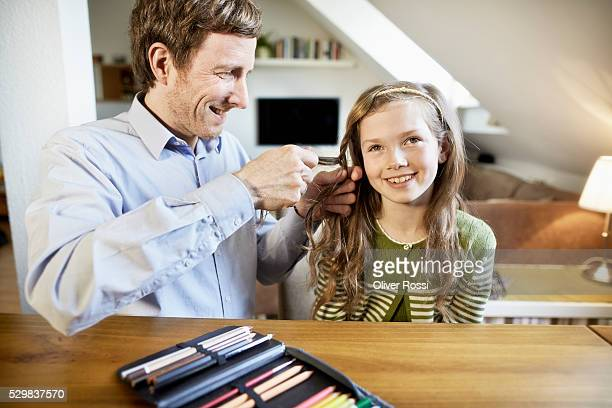 Father and daughter at home