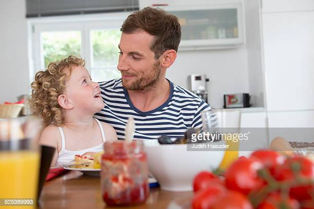 Father and daughter at kitchen table