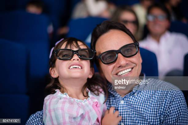 Father and daughter at the cinema