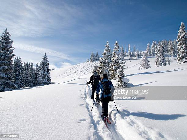 father and daughter back-country skiing - steamboat springs colorado stock photos and pictures