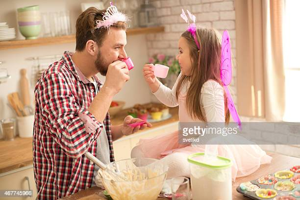 father and daughter baking and having tea party in kitchen. - princess stock pictures, royalty-free photos & images
